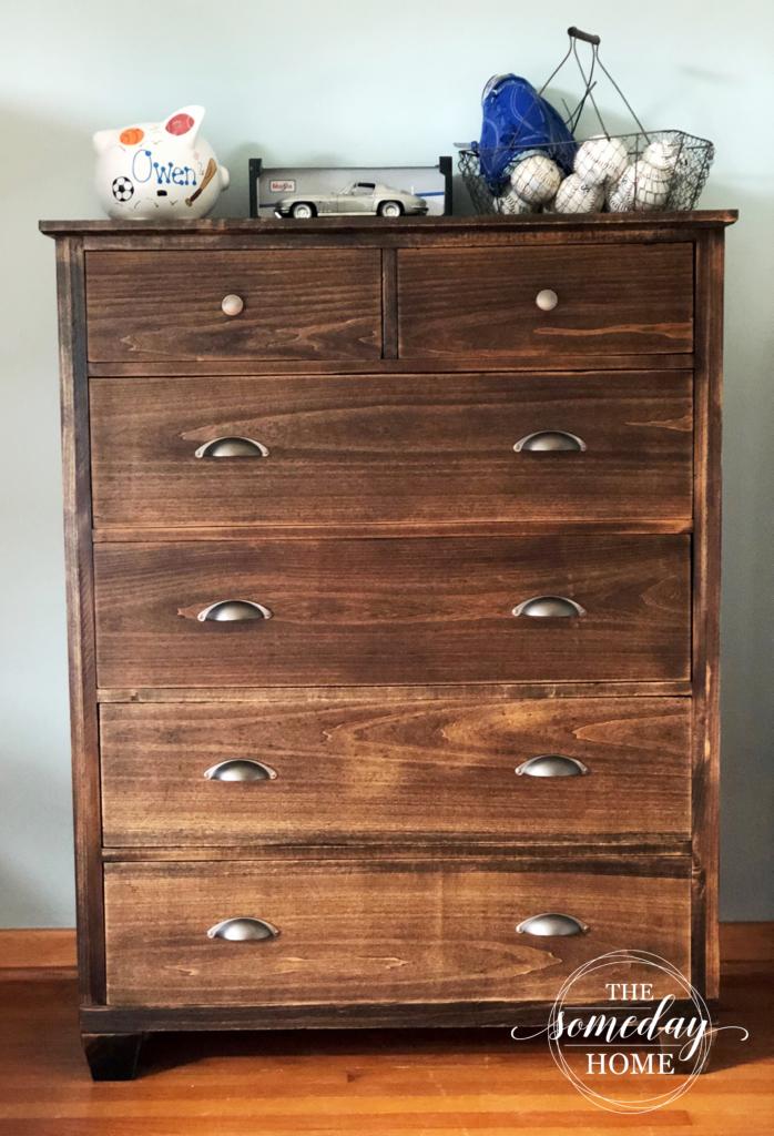 dresser with piggy bank and baseballs
