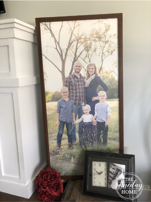 diy photo transfer 3, framed family photo sitting on a wooden box with a bouquet and clock next to it.