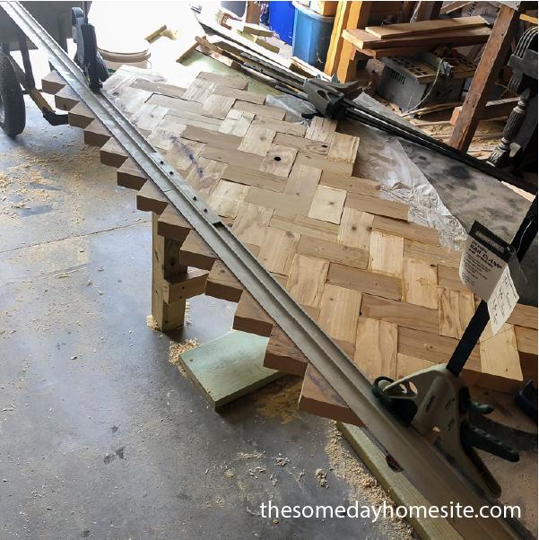 diy herringbone table top being cut down with circular saw