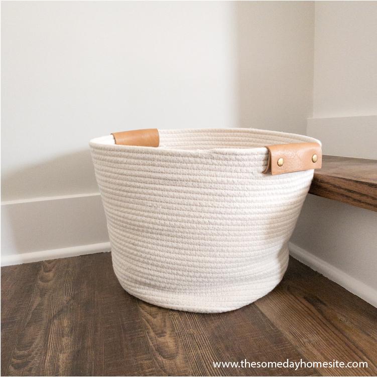 cream colored basket on brown wood floor