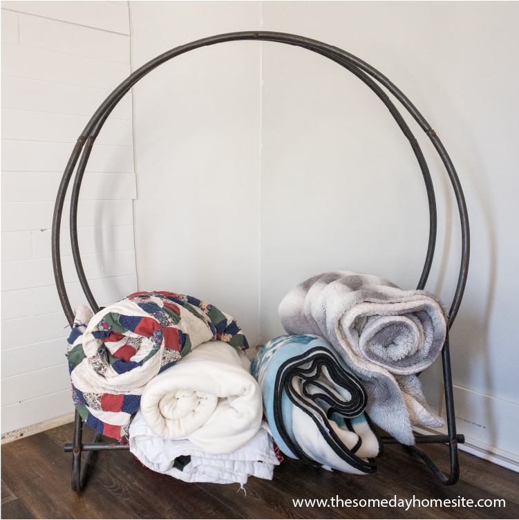 firewood ring holding rolled blankets