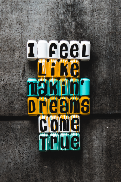 """cans stacked that say """"I feel like makin' dreams come true"""""""
