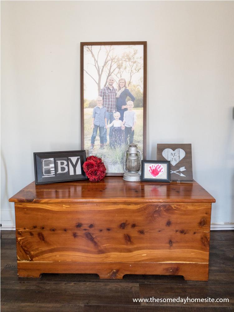 cedar chest with framed photos on top of it