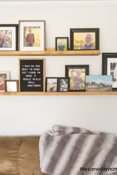 brown couch with a grey wall and two brown wooden shelves above it, Simple DIY Picture Ledge Shelves