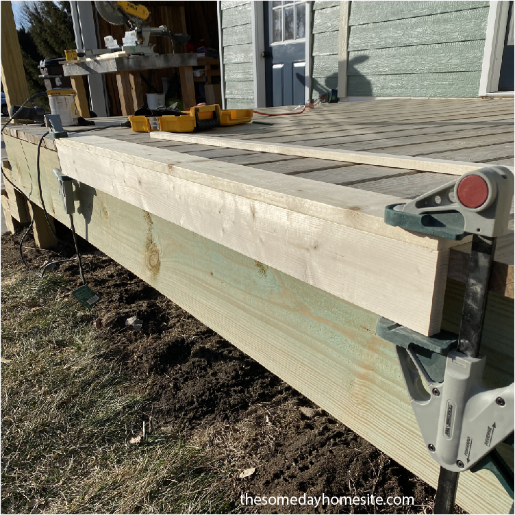 two pieces of wood clamped together, Simple DIY Picture Ledge Shelves